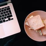 Sad Desk Lunch Sandwiches beside a laptop