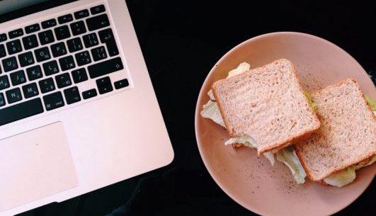 Sad Desk Lunch Sandwiches beside a laptop