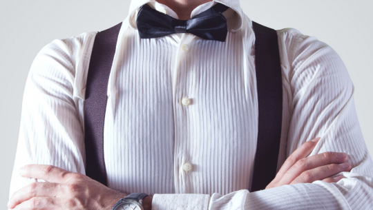 workplace bully | Torso of a well dressed man with arms crossed